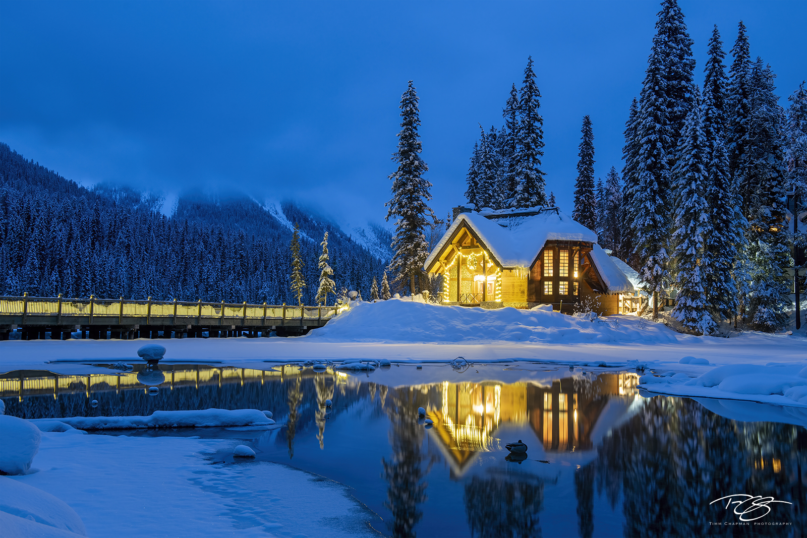 As a cold wintry night begins, a lodge in the mountains affords a warm respite.